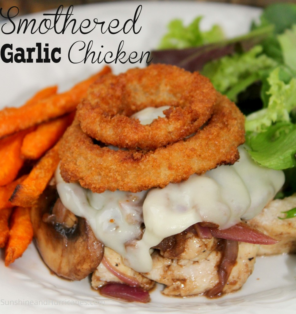 Smothered Garlic Chicken is a fast and easy dinner idea that is ready in 30 minutes or less! Serve with some delicious sweet potato fries and salad!