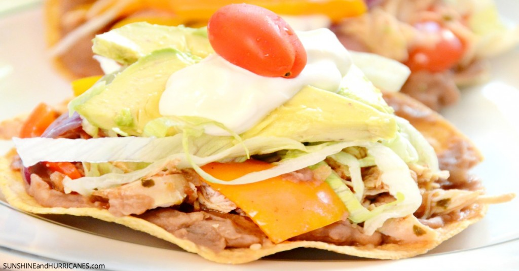 Looking for an easy and delicious family friendly meal? These slow cooker chicken tostadas are sure to be a hit and create a fun family meal for anytime. Slow Cooker Chicken Tostadas. SunshineandHurricnaes.com