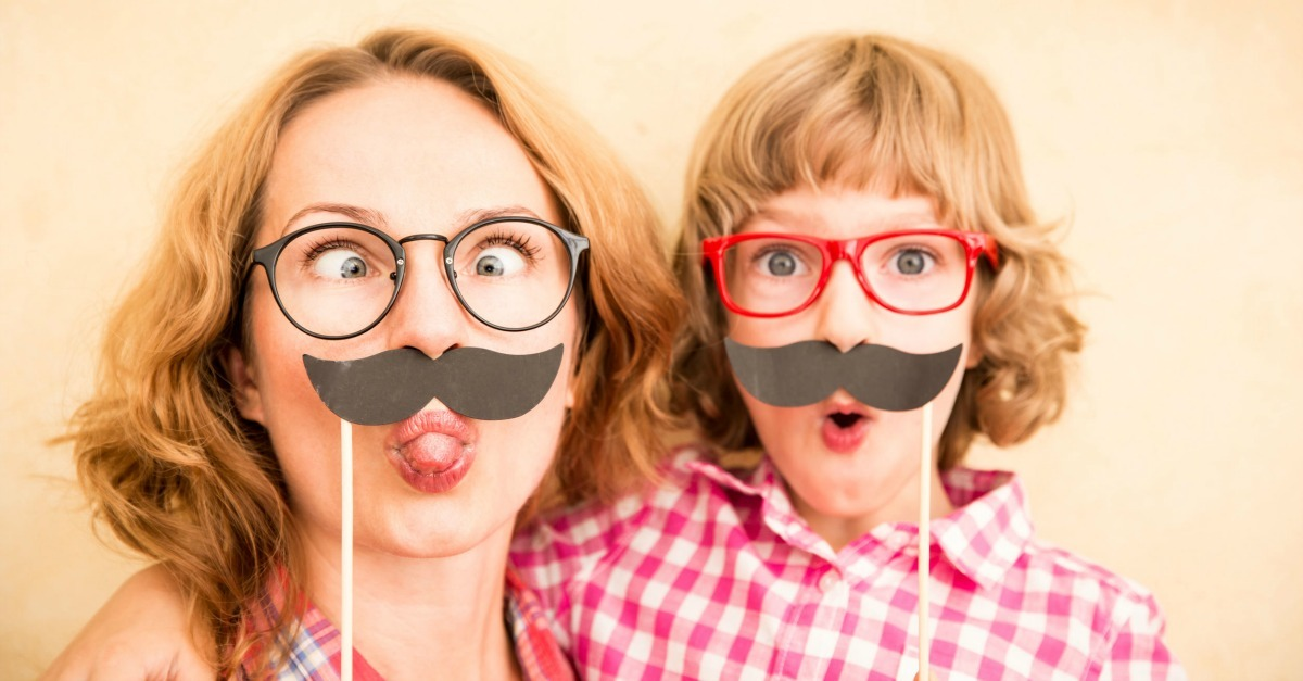 10 Ways to Be Silly and Laugh With Your Kids - Take Photos with Photo Props