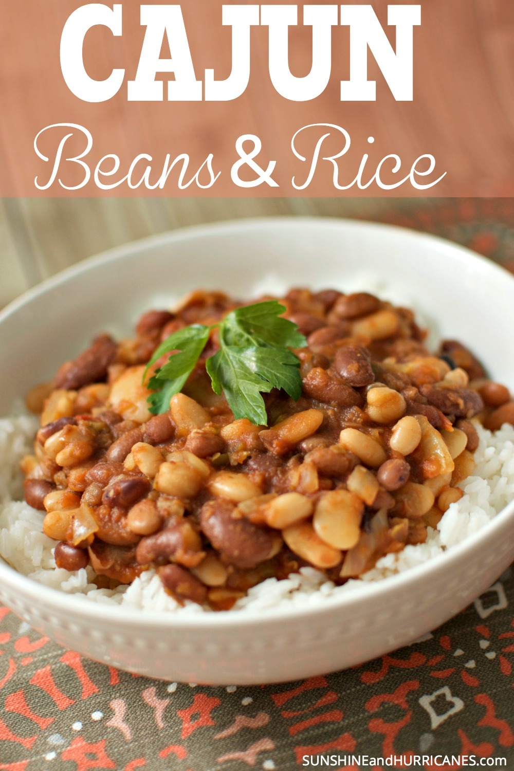 Looking for an easy rice and beans recipe with just a hint of spice? This dish is perfect for everything from a delicious family dinner to a potluck. It's a meal that can feed a crowd or just a few with leftovers to freeze. Cajun Rice and Beans Recipe from SunshineandHurricanes.com