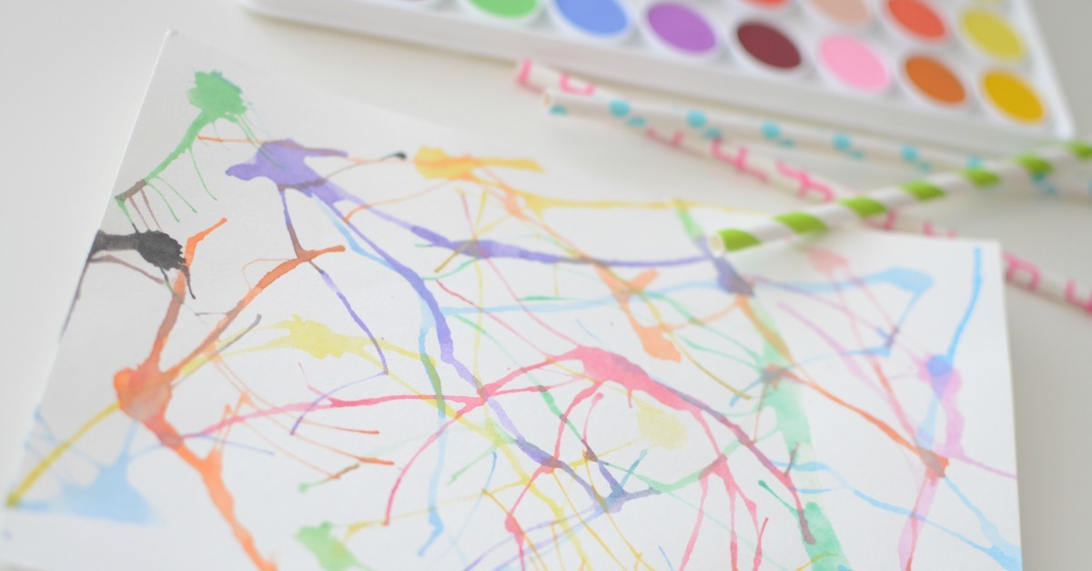 Watercolor art for kids using straws. A fun and easy activity to inspire little artists with masterpieces that are so pretty you will actually want to hang them up and show them off.